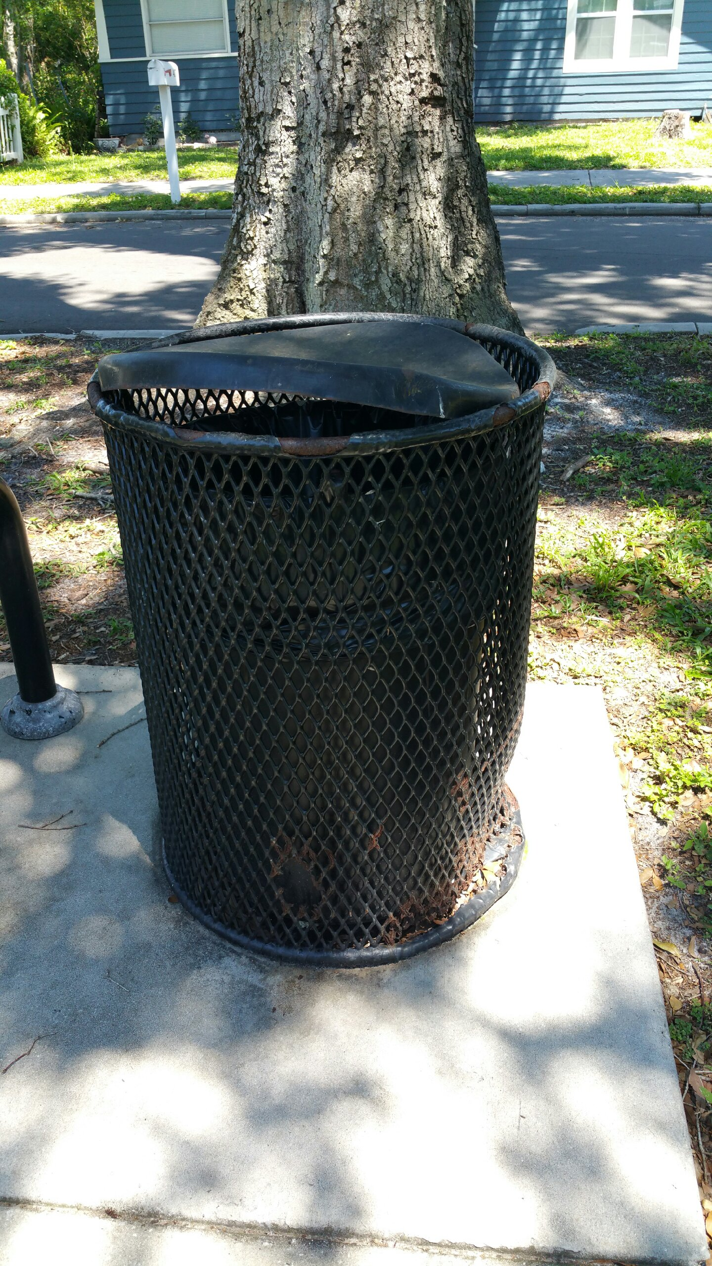 Garbage Cans were bent and rusted in the Plaza Park